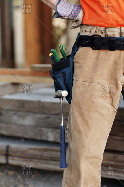 Closeup of male construction worker wearing tool belt