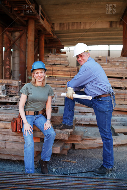 Portrait of male and female construction workers