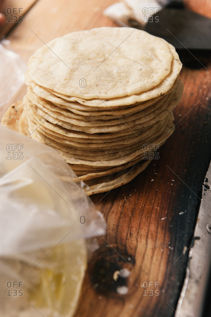 A stack of fresh tortilla shells at a roadside taqueria in Mexico