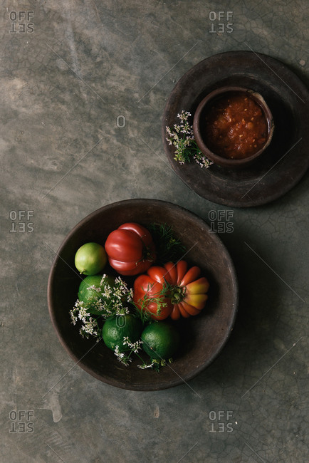 Fresh tomato, lime, flowers, and salsa from overhead