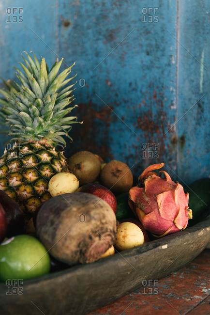 Wooden bowl of fresh tropical fruits at an outdoor bar in Mexico