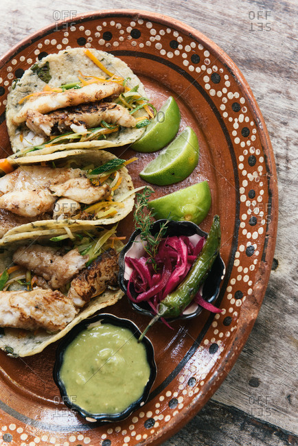 Fish tacos on freshly made tortillas and traditional Mexican platter