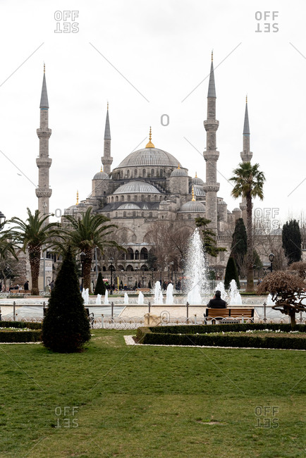 February 19, 2018: People and fountain in front of the Sultan Ahmed Mosque. Istanbul, Turkey