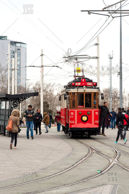 February 19, 2018: People walk and use tram through Istiklal Street. Istanbul, Turkey