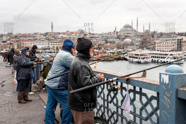 February 19, 2018: Fisherman on the Galata Bridge at Golden Horn. Istanbul, Turkey