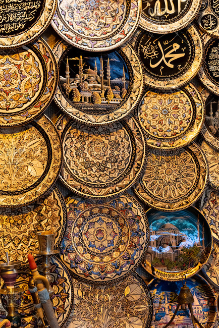 February 20, 2018: Decorative plates with drawings of Istanbul landmarks at a market stall. Istanbul, Turkey