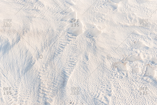 Abstract white limestone textured background in sunny day, Pamukkale, Turkey