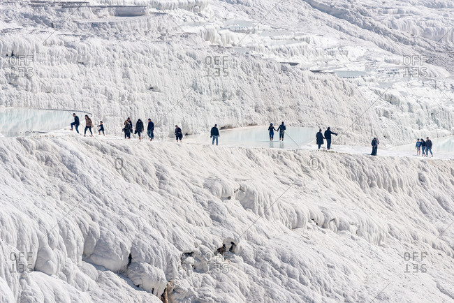 February 18, 2018: People visiting the Travertines: some limestone natural ponds in Pamukkale, Turkey.