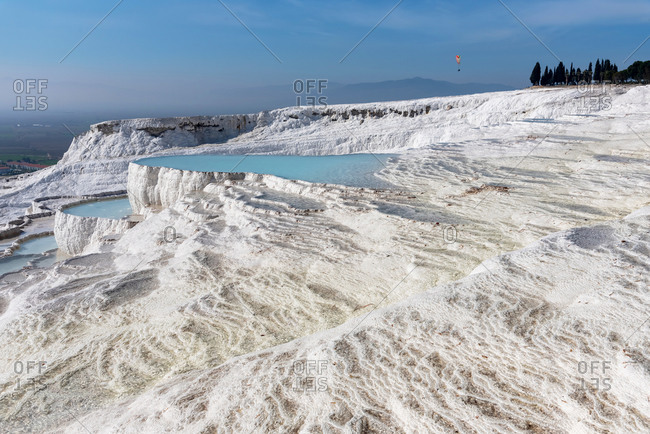 Natural pools in limestone mountains filled with blue water in Pamukkale, Turkey