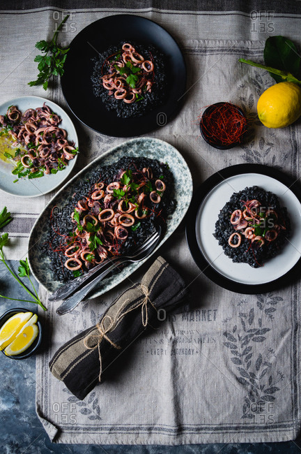 Black risotto dish with cuttlefish ink and squid salad