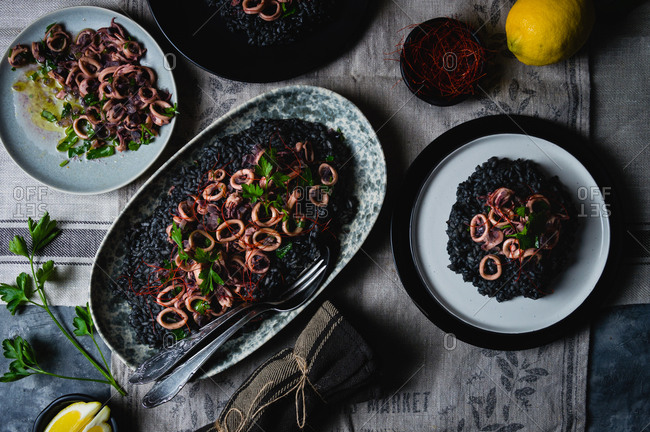 A black risotto with cuttlefish ink and squid salad