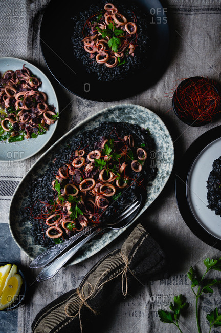 Black risotto with cuttlefish ink and squid salad viewed from above
