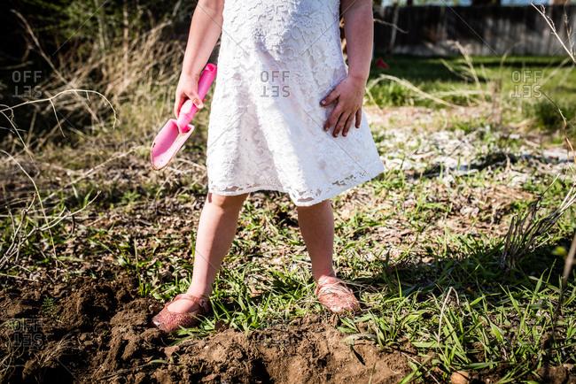 Little girl holding a pink shovel