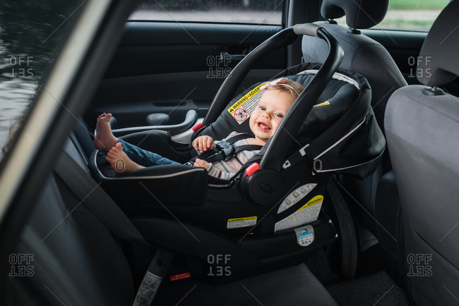 Happy baby girl riding in infant car seat