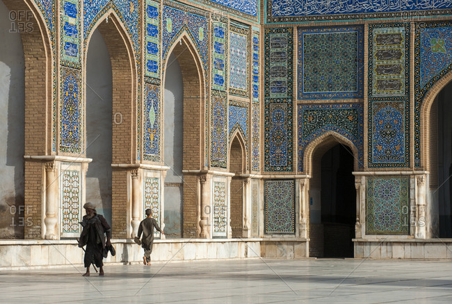 Herat, Afghanistan - June 16, 2011: Herat, Afghanistan - June 16, 2011: A man goes to pray in the Friday Mosque