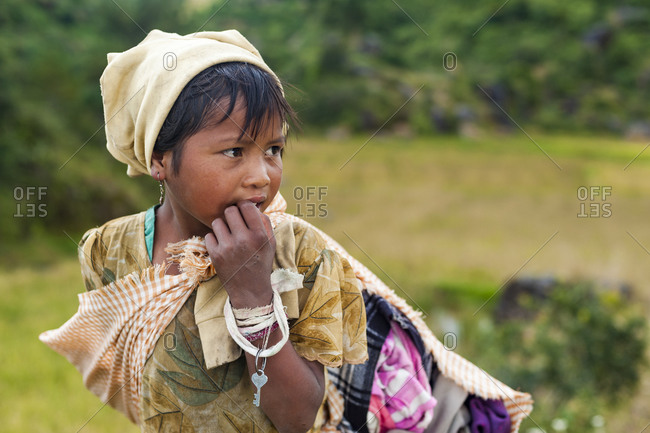 Meghalaya, India - October 23, 2010: A little hard working girl from Assam in India
