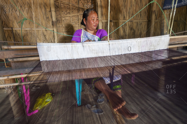 Weaving a Punin on a traditional hand loom in India