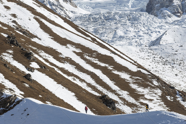 A man trekking to the summit of Kyanjin Ri in the Langtang valley in Nepal