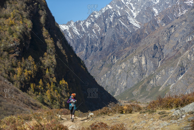 A woman trekking in the Nepal Himalayas in the Langtang Valley