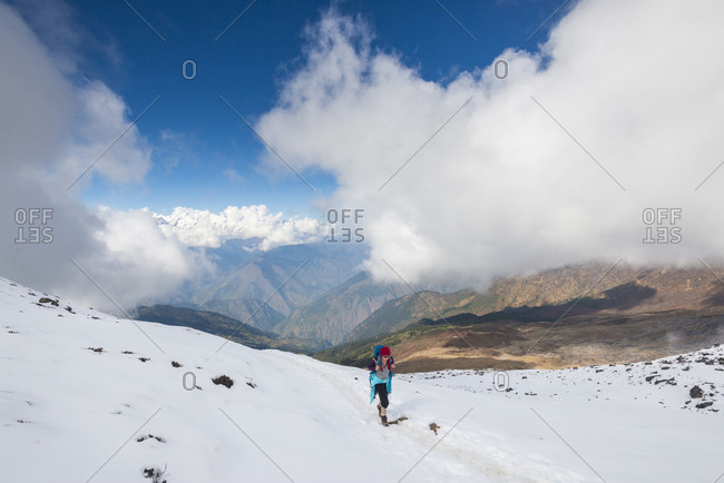 Trekking on a snow slope from Sian Gompa to Gosainkund and the Laurebina La in the Langtang region of Nepal