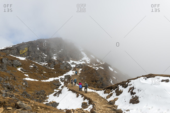 Trekkers climb the trail from Sian Gompa to Gosainkund and the Laurebina La in the Langtang region of Nepal