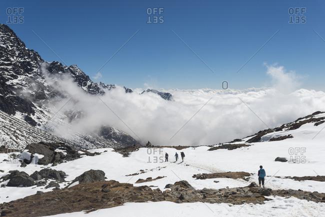 Descending the Laurebina La from Langtang and into cloud towards Helambu