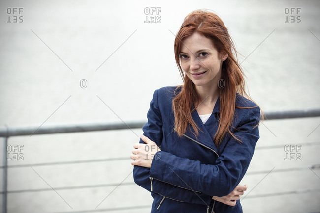 Smiling mid adult woman standing outdoors