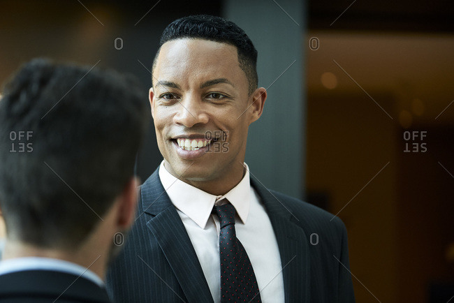Businessman talking with his colleague in hotel