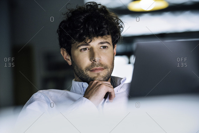 Businessman using laptop to get some work done