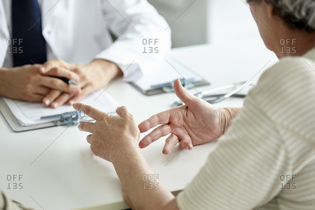Patient talking with doctor in a room