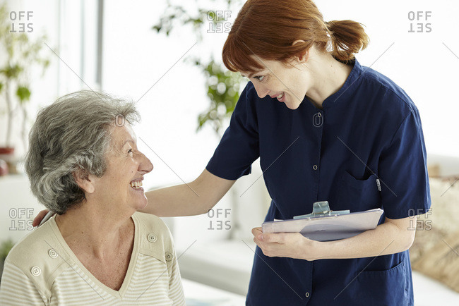 Nurse talking to patient in a room