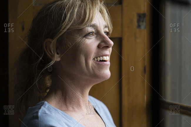 Close-up of thoughtful woman looking through window