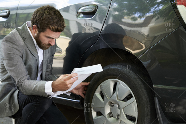 Man examining car in show room
