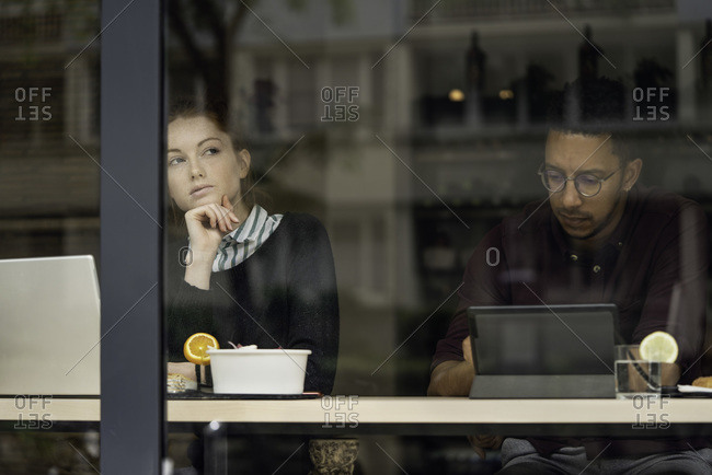 Couple sitting in restaurant about to eat