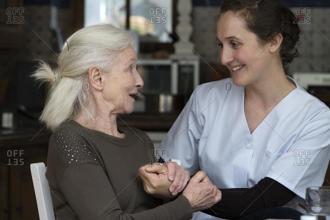 Senior patient talking with nurse