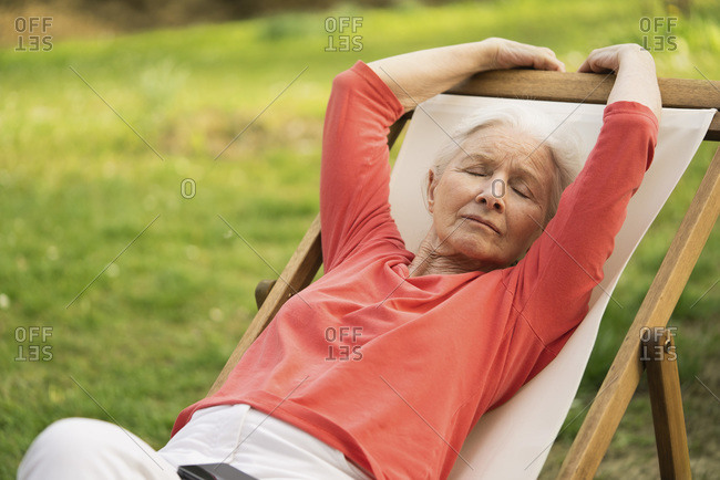 Senior woman relaxing on chair