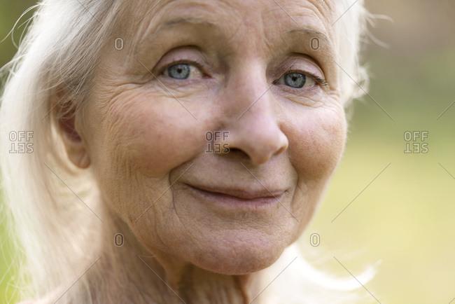 Portrait of senior woman standing alone