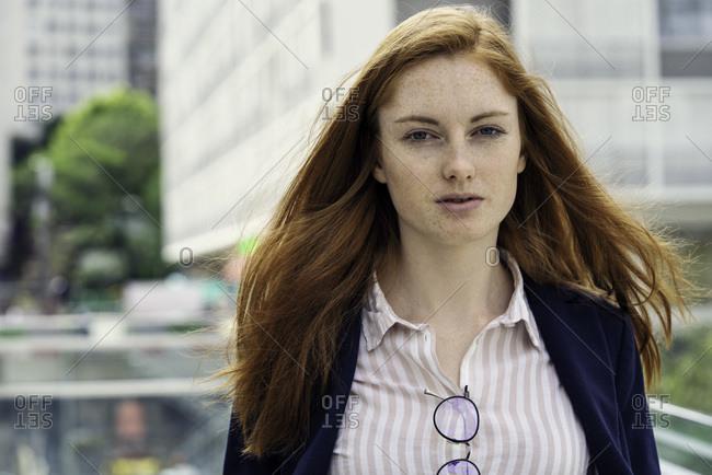 Portrait of businesswoman standing alone