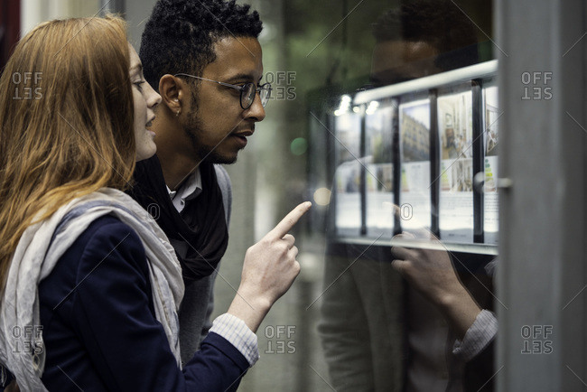 Couple looking at window display