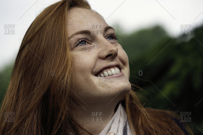 Young woman smiling standing alone
