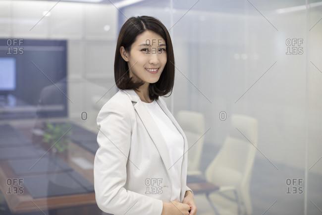 Portrait of confident Chinese businesswoman