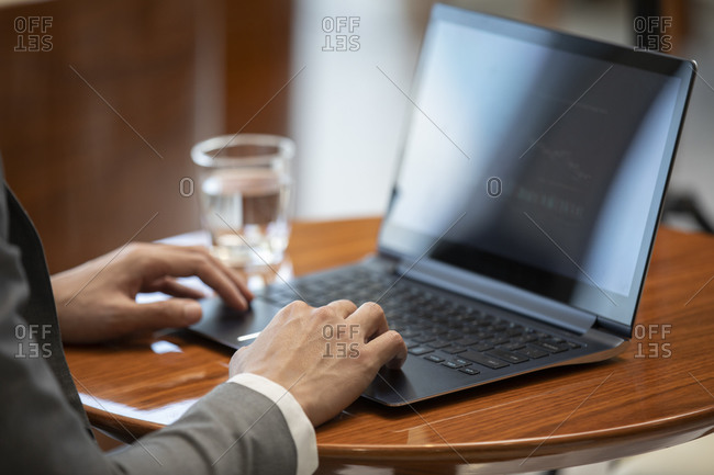 Confident Chinese businessman using laptop