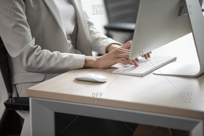 Young Chinese businesswoman working in office
