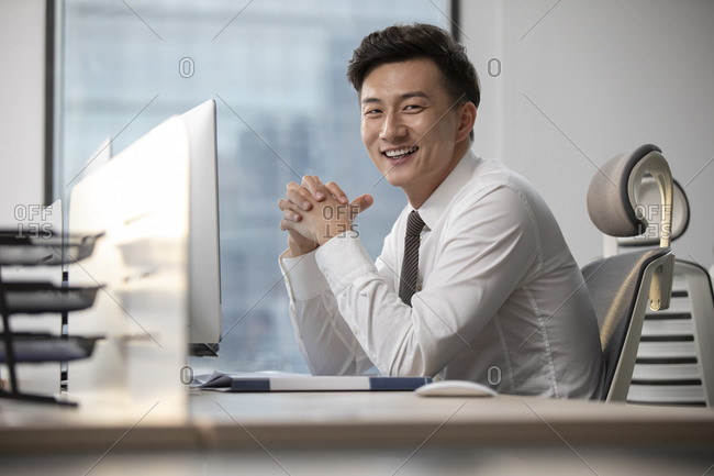 Young Chinese businessman working in office