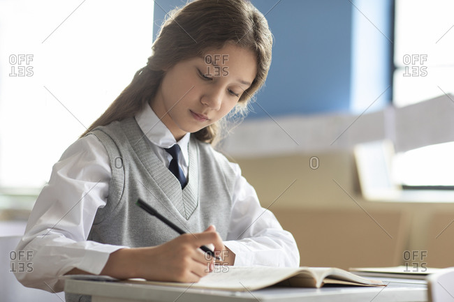 Little girl learning in classroom