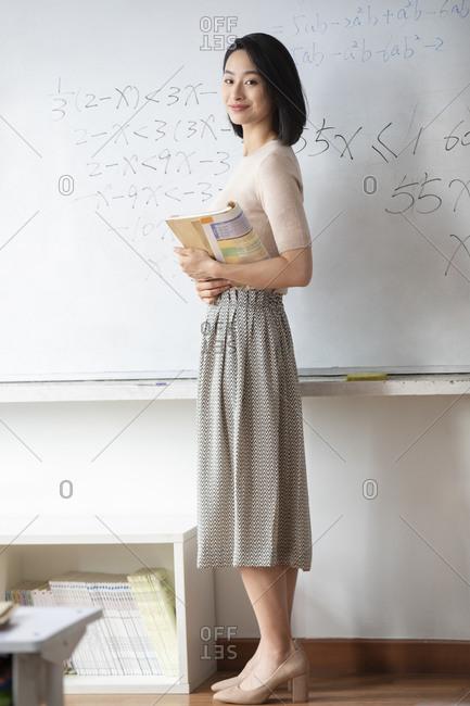 Young Chinese teacher teaching a class
