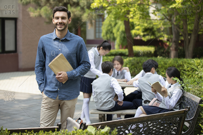 Teacher and students on campus