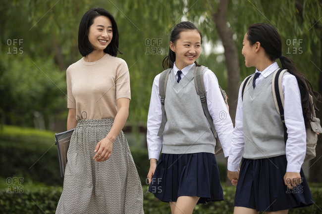 Chinese teacher talking with student on campus