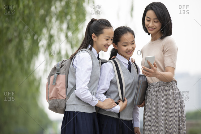 Chinese teacher showing students smartphone