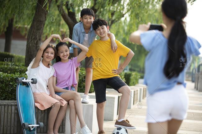 Teenagers having fun in park